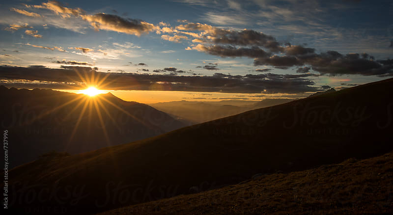 Sunset flare in the mountains of the Andes by Mick Follari for Stocksy United