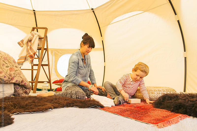 Glamping - Caucasian Mother Playing With Her Son in Spacious Circular Tent by Julien L. Balmer for Stocksy United