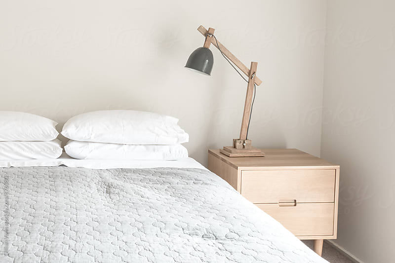 modern minimalist bedroom by Gillian Vann for Stocksy United