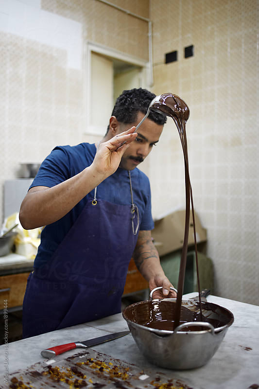Artisan chocolate maker at work by Miquel Llonch for Stocksy United