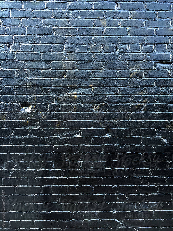 Dark Brick Wall by Good Vibrations Images for Stocksy United
