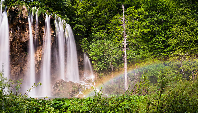 Waterfalls and Rainbow by Andreas Wonisch for Stocksy United