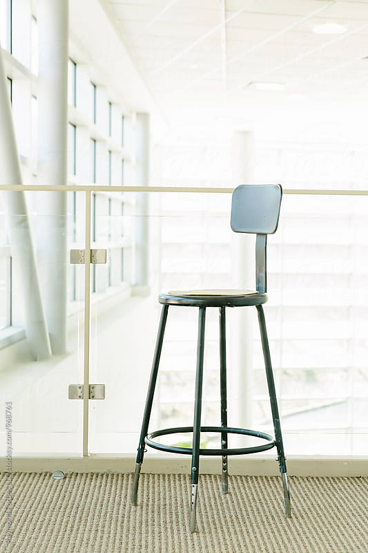 Stool in the Lobby by Raymond Forbes LLC for Stocksy United