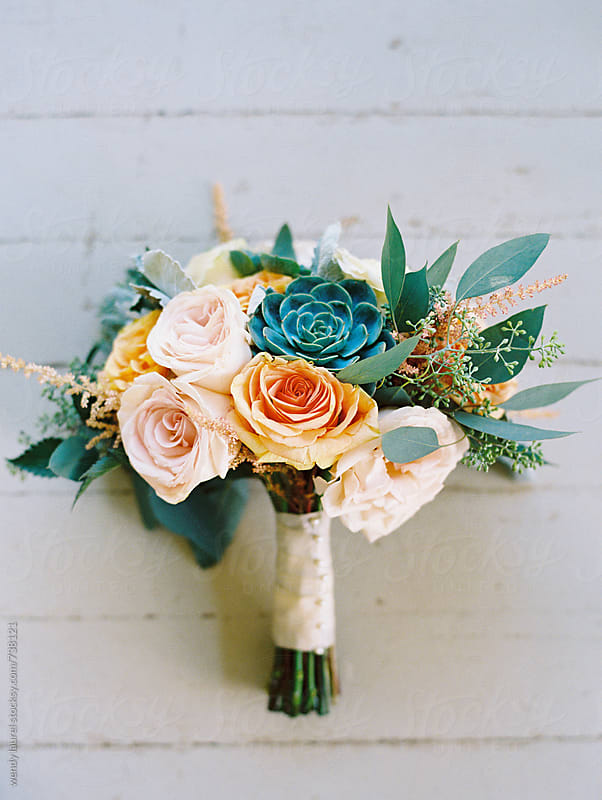 wedding bouquet of peach and pastel flowers by wendy laurel for Stocksy United
