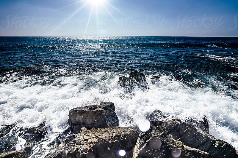 waves hitting the rocks by Juri Pozzi for Stocksy United