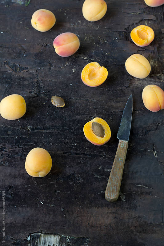 Apricots on weathered wood by Noemi Hauser for Stocksy United