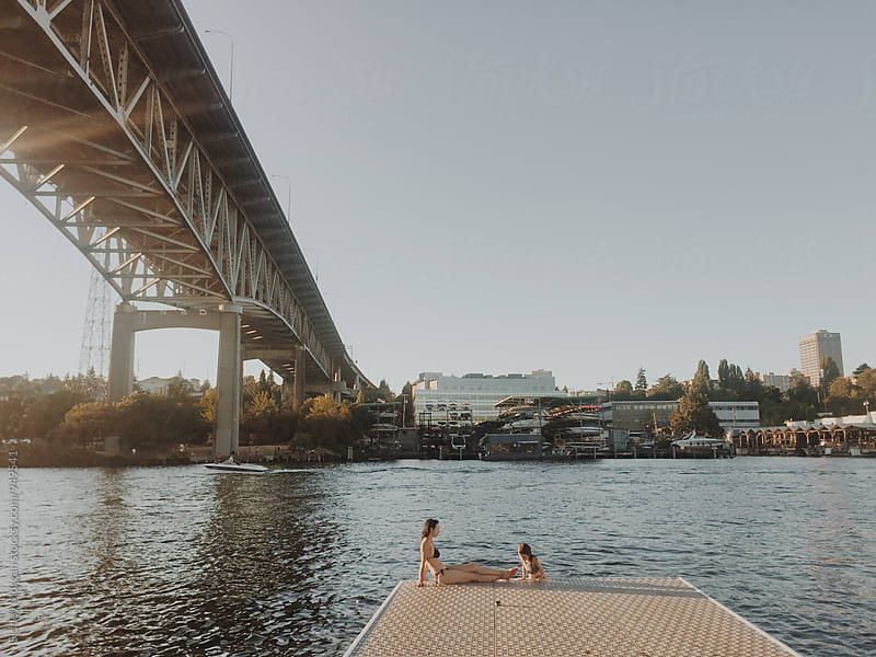 Rachelle & Ava on the Water in Seattle by Sidney Morgan for Stocksy United