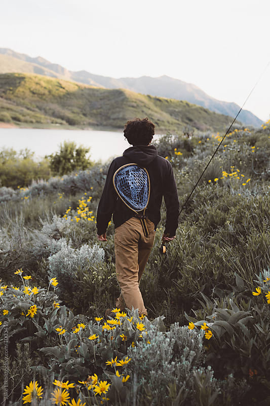 Man Hiking With Fly Fishing Gear by Jake Elko for Stocksy United