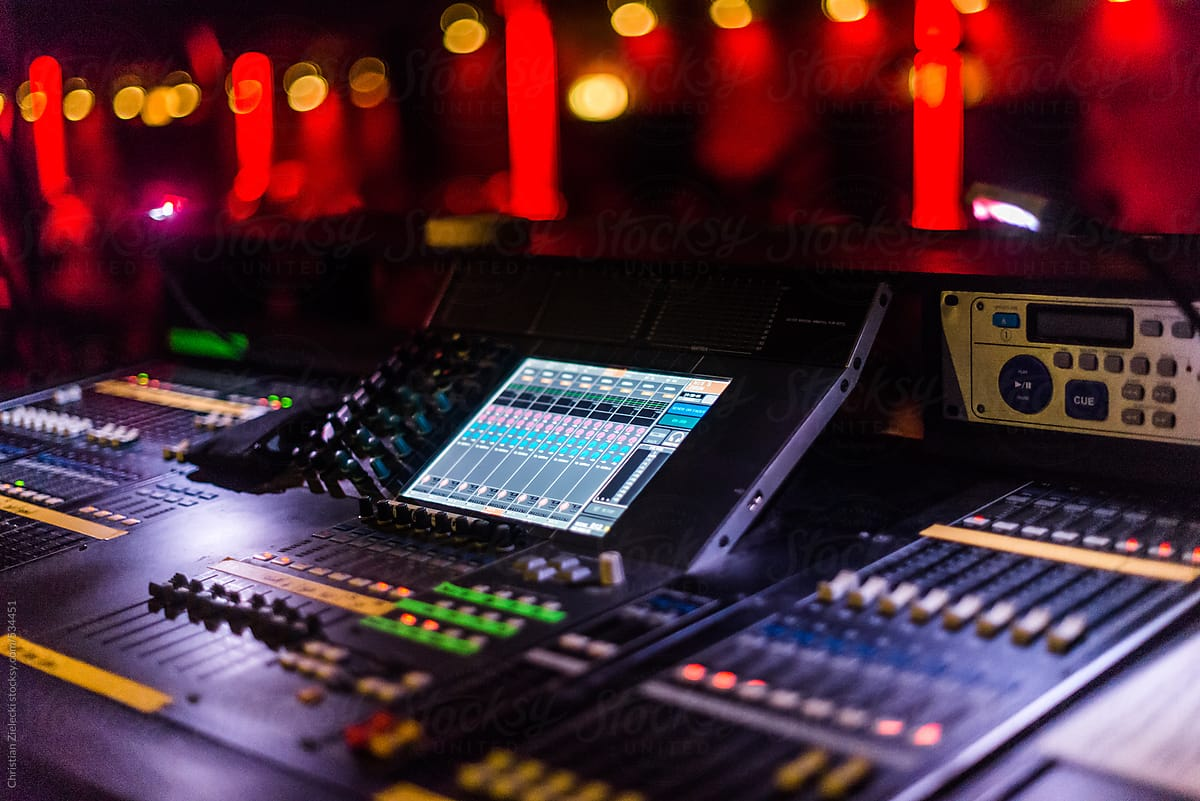 a sound mixer at a concert by Chris Zielecki - Stocksy United