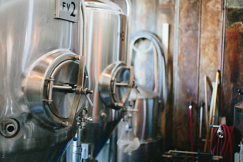Brewery vats holding beer by Matthew Spaulding for Stocksy United