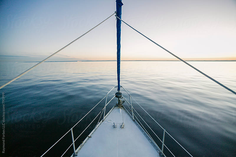 Sailboat on Sunset Cruise by Raymond Forbes LLC for Stocksy United