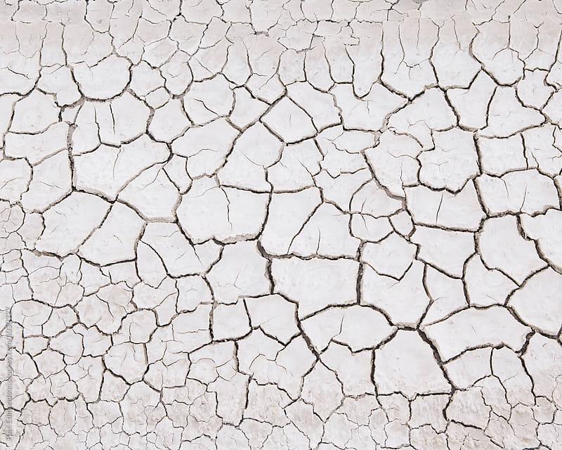 Close up of cracked earth, Black Rock Desert, Nevada by Paul Edmondson for Stocksy United