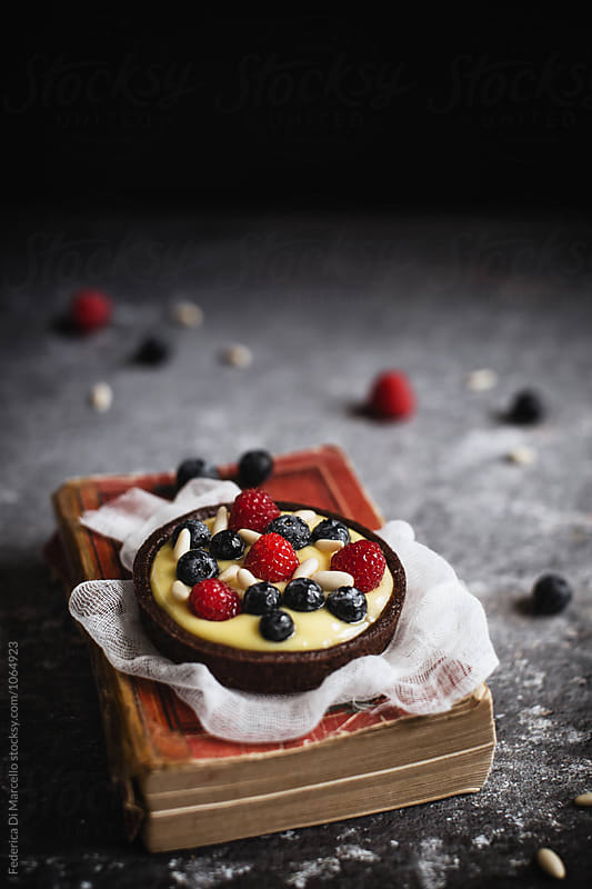 Berry and cream tartlets by Federica Di Marcello for Stocksy United
