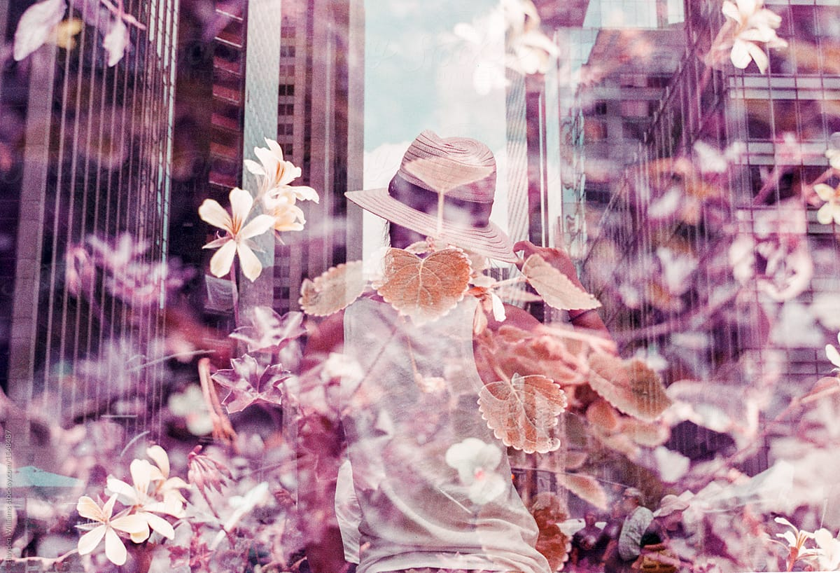 9a846868e26 Young girl with hat walking through flower-filled street in New York City  by Hayden