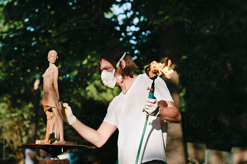 artist applying patina to sculpture by Jess Lewis for Stocksy United