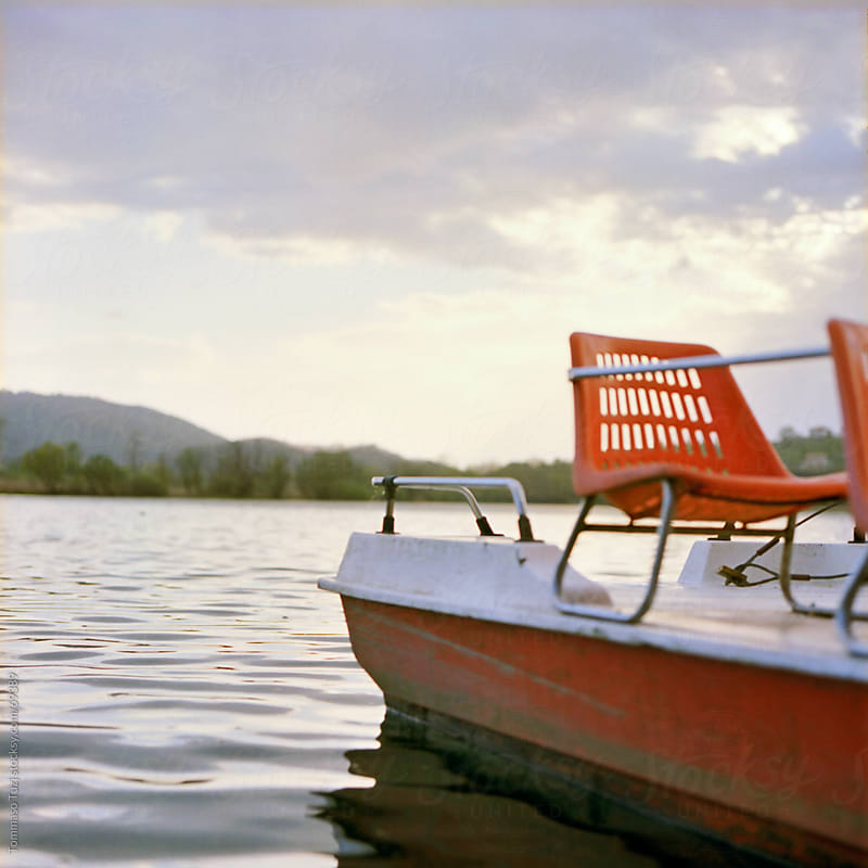 boat on the lake by Tommaso Tuzj for Stocksy United