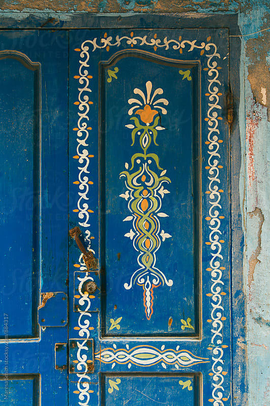 A pretty hand-painted wooden door by Maresa Smith for Stocksy United