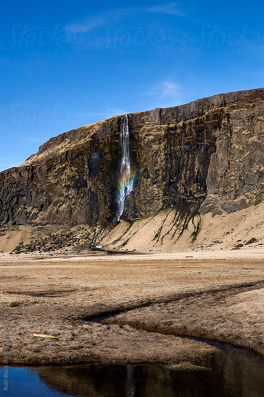 Icelandic waterfall with rainbow by Ruth Black for Stocksy United