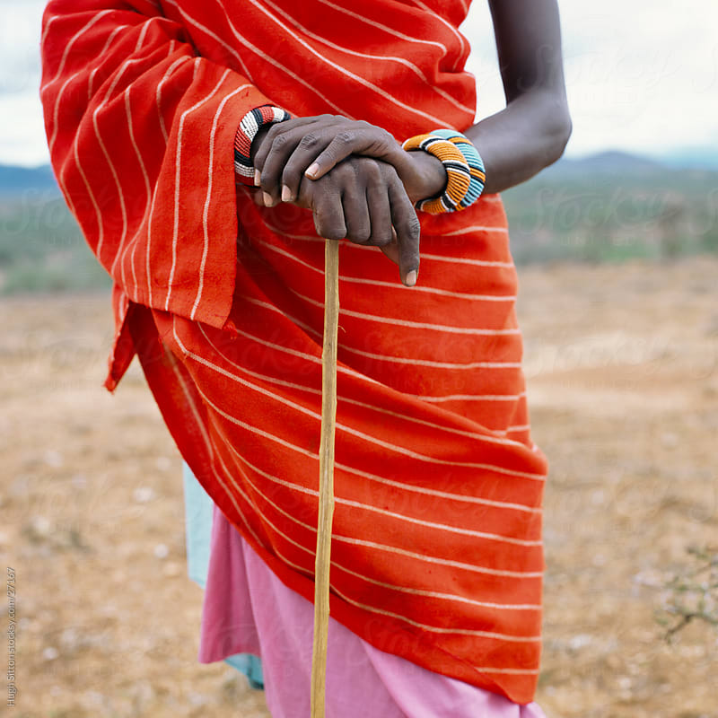 Close-up of Samburu warrior holding cane. Kenya by Hugh Sitton for Stocksy United