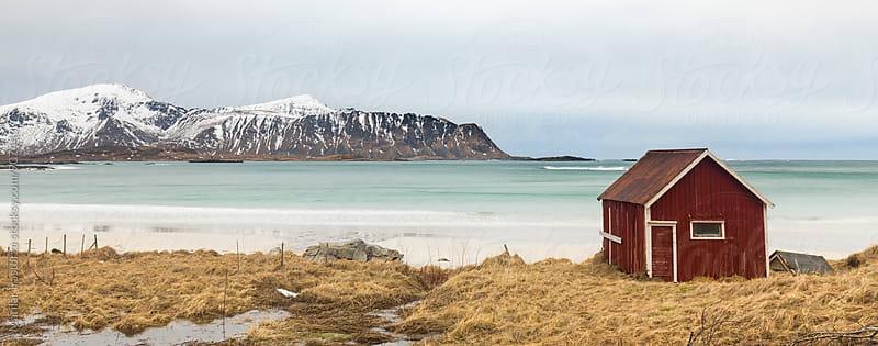 Old fishermen's cabin in a Norwegian beach by Marilar Irastorza for Stocksy United