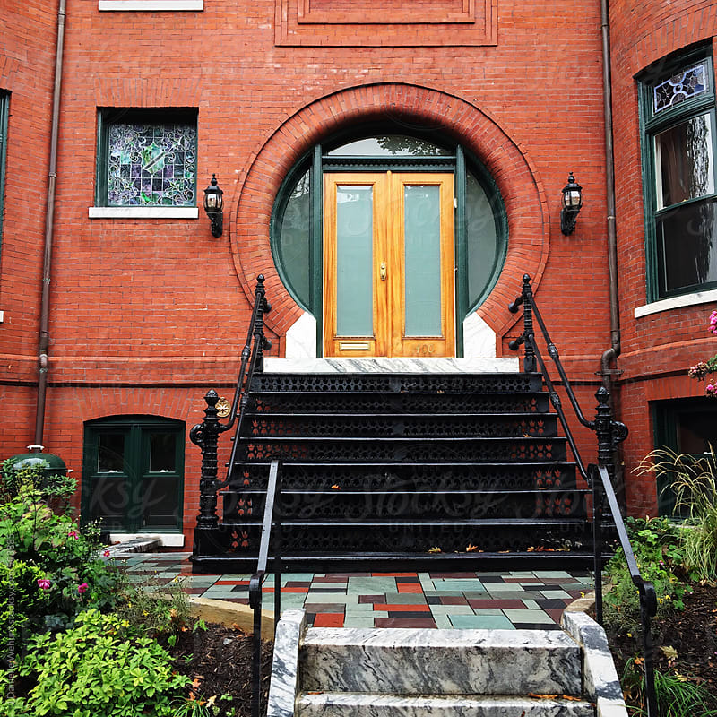 A round doorway on a brick building. by J Danielle Wehunt for Stocksy United
