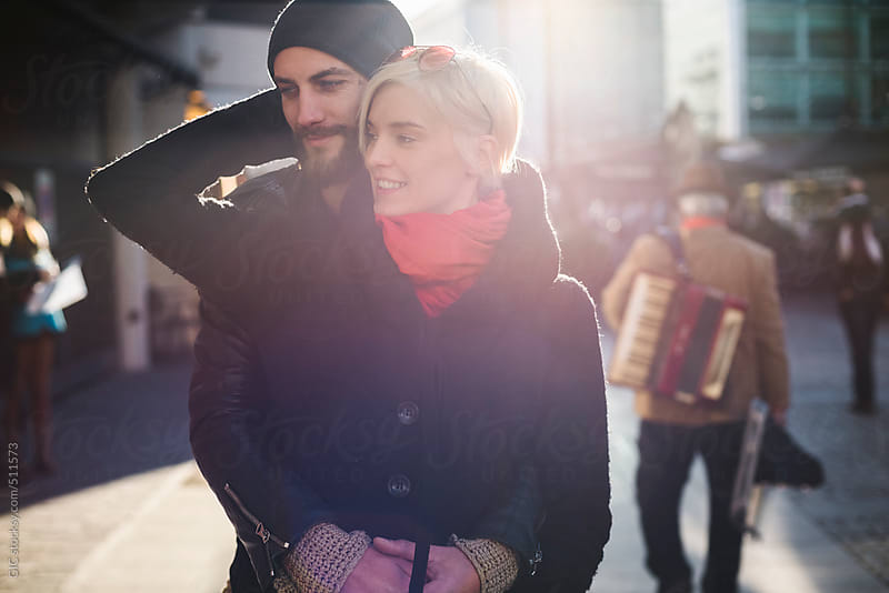 Affectionate young couple portrait in the city by GIC for Stocksy United