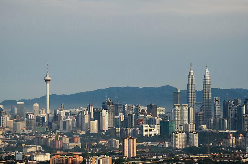 View to Kuala Lumpur in soft morning light by Alice Nerr for Stocksy United