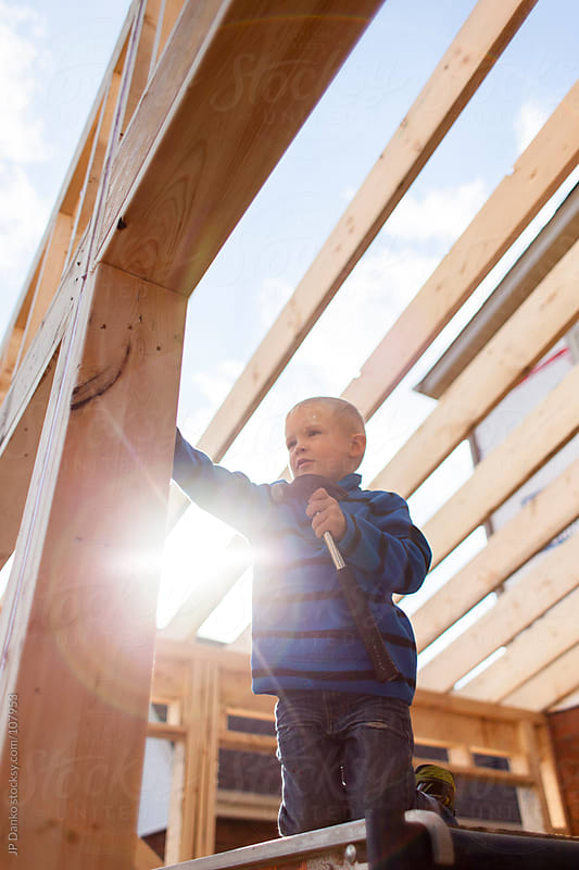 Little Boy Pretending to be Home Builder Framing Contractor by JP Danko for Stocksy United