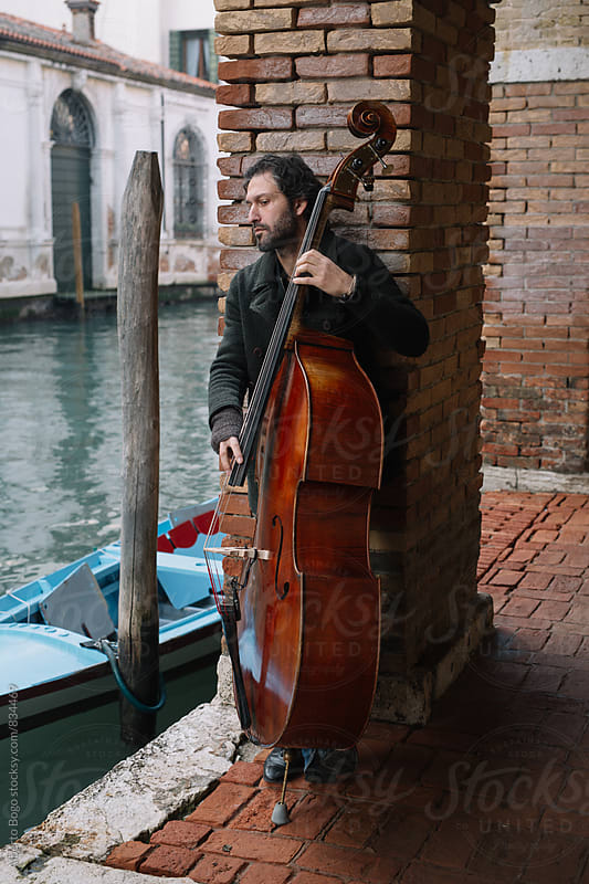 Portrait of double bass musician in outdoor by Alberto Bogo for Stocksy United