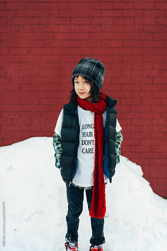 Young mixed race boy in snow by Kelli Seeger Kim for Stocksy United