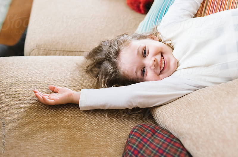 Happy and cute little girl at home by Simone Becchetti for Stocksy United
