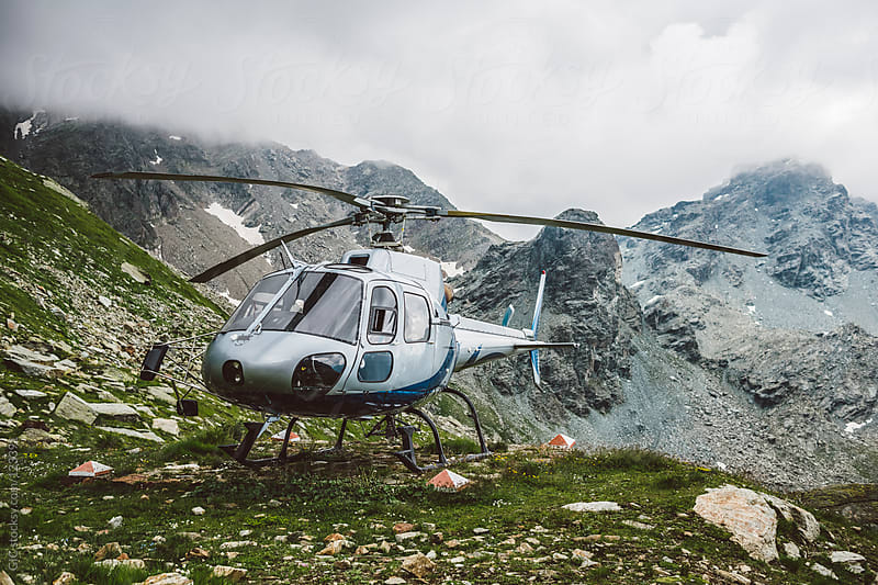 Helicopter on the mountain by GIC for Stocksy United