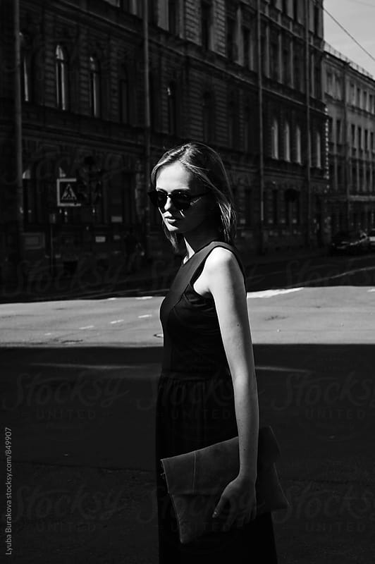 Young woman in contrast light by Lyuba Burakova for Stocksy United