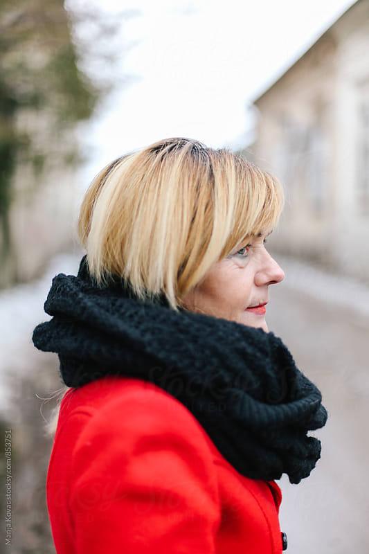 Portrait of a beautiful blonde woman in the street  by Marija Kovac for Stocksy United