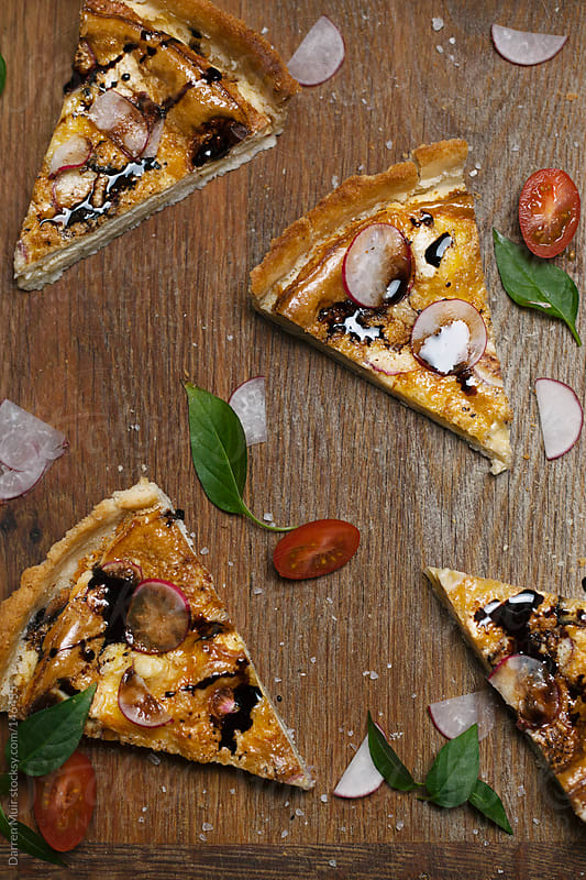 Sliced quiche.  by Darren Muir for Stocksy United