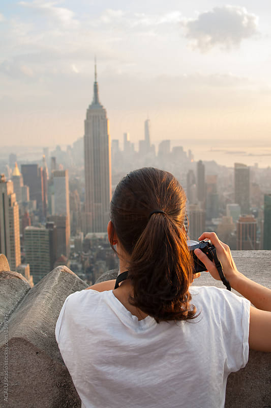 Tourist photographing the Empire State by ACALU Studio for Stocksy United