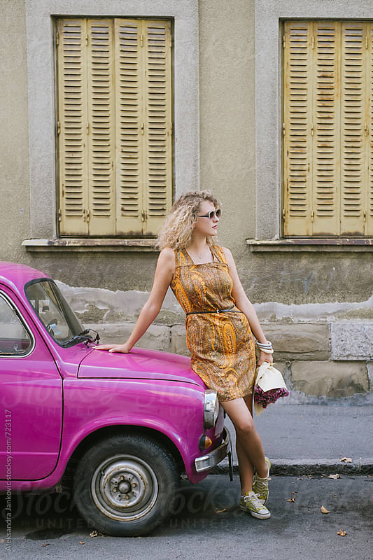 Attractive Blond Woman Standing in Front of the Cute Pink Car Parked on the Street by Aleksandra Jankovic for Stocksy United