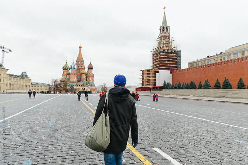 Man walking at Red Square, Moscow by Andrey Pavlov for Stocksy United