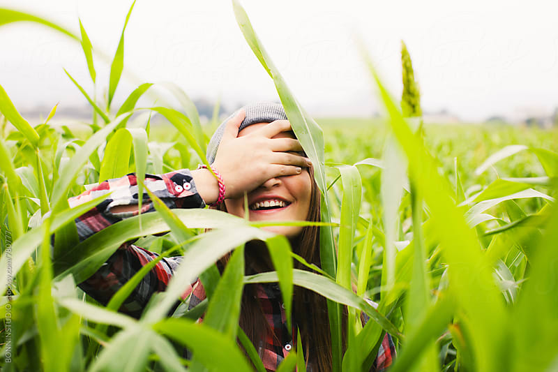 A 14 years old girl having fun in a corn field. by BONNINSTUDIO for Stocksy United