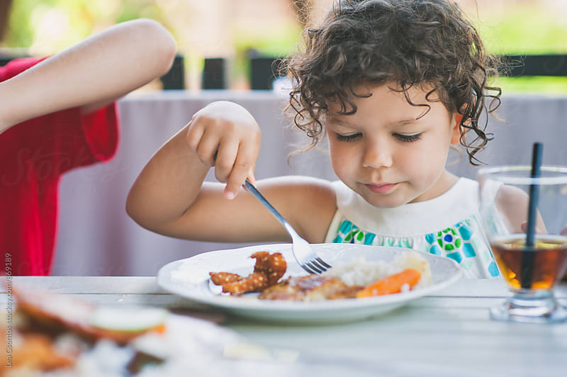 Child having a meal outdoors in summer. by Lea Csontos for Stocksy United