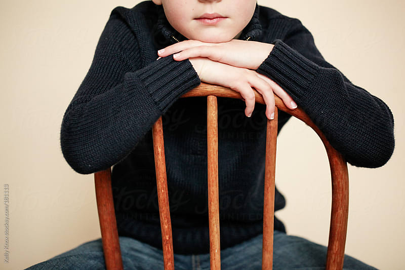 portrait of an anonymous young boy by Kelly Knox for Stocksy United