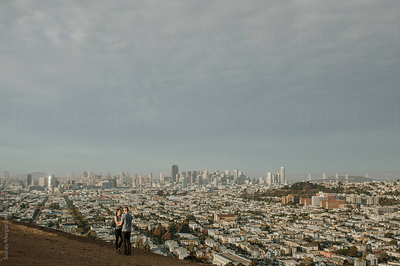 Couple above San Francisco by Sidney Morgan for Stocksy United