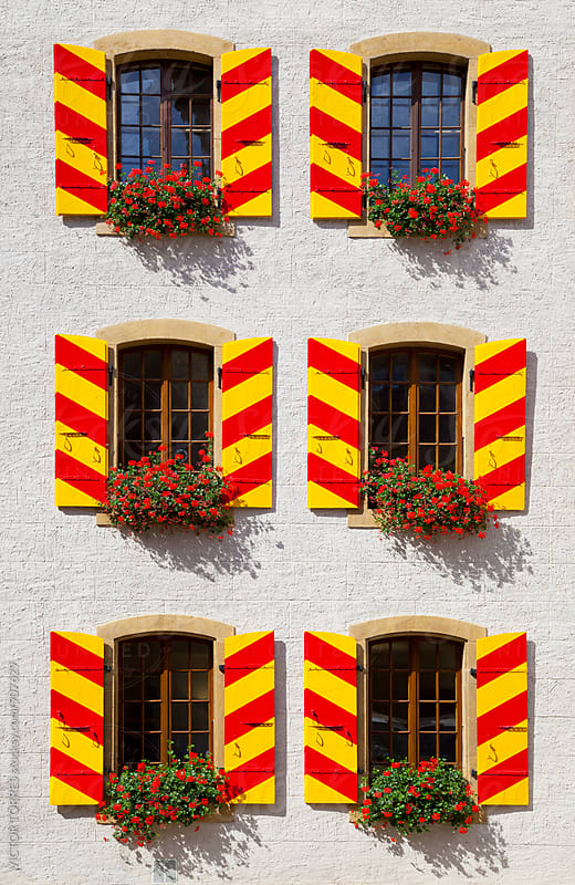 Windows pattern in Neuchatel, Switzerland by Victor Torres for Stocksy United