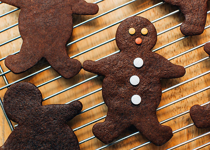 pills decorating a gingerbread man  cookie by Deirdre Malfatto for Stocksy United