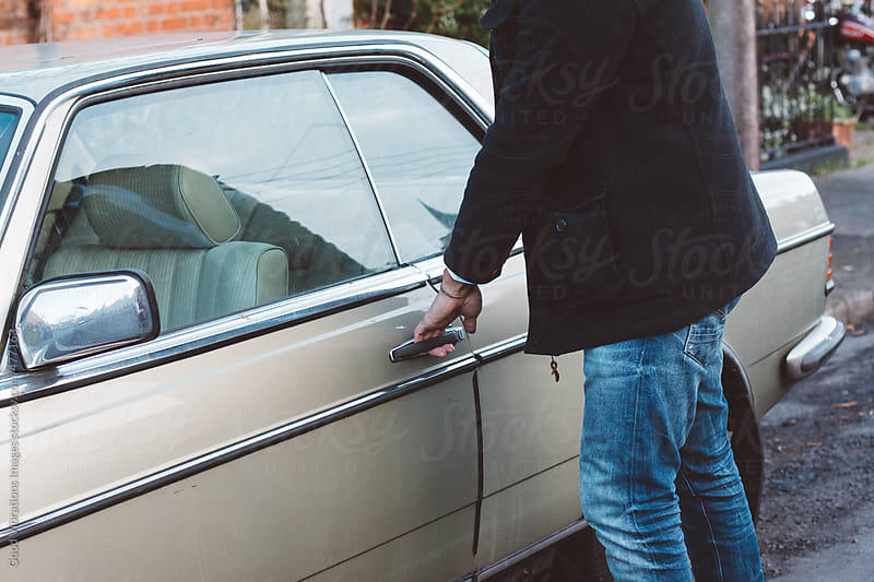 Man approaching his car parked on the street by Good Vibrations Images for Stocksy United