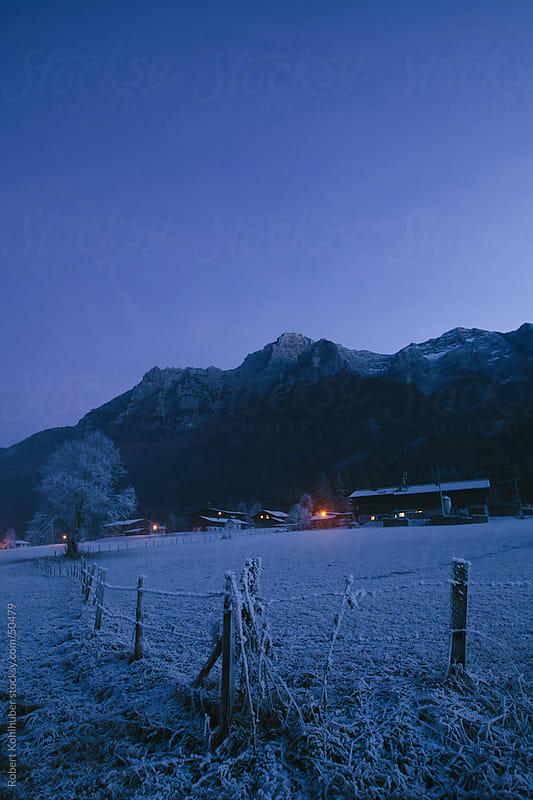 Winter landscape at night by Robert Kohlhuber for Stocksy United