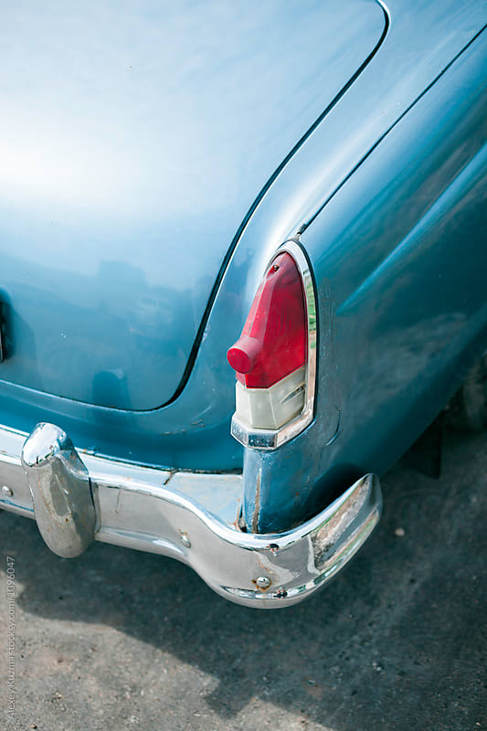 closeup of a blue classic vintage car  by Alexey Kuzma for Stocksy United