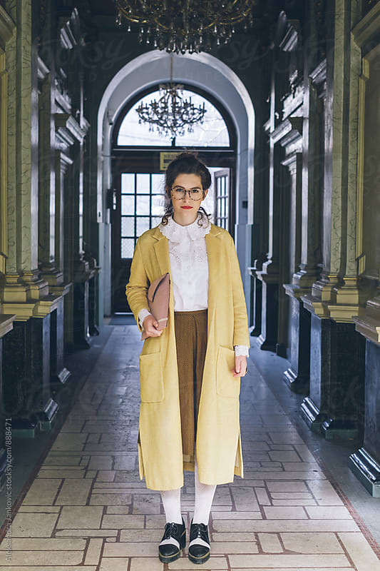 Portrait of a Styilsh Young Woman Wearing Vintage Yellow Coat by Aleksandra Jankovic for Stocksy United