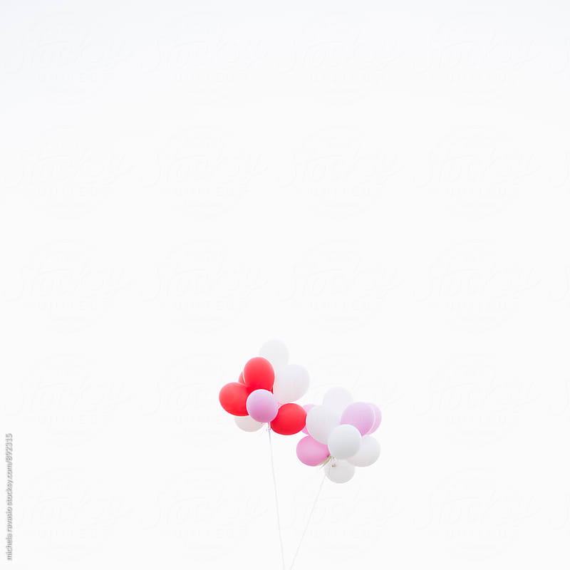 Bunch of balloons flying in the sky by michela ravasio for Stocksy United