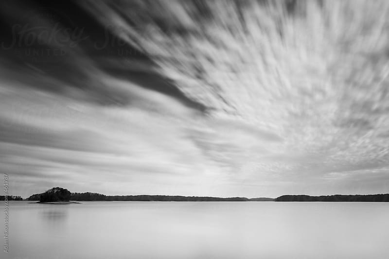 Cloud formation over a lake by Adam Nixon for Stocksy United